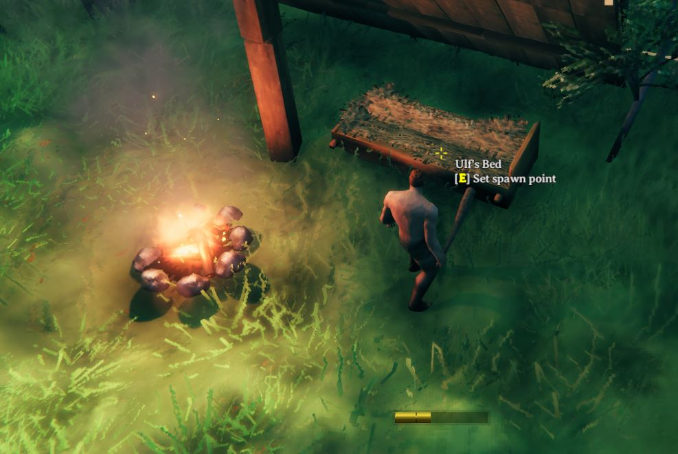 Set a spawn point in Valheim by pressing E on the bed