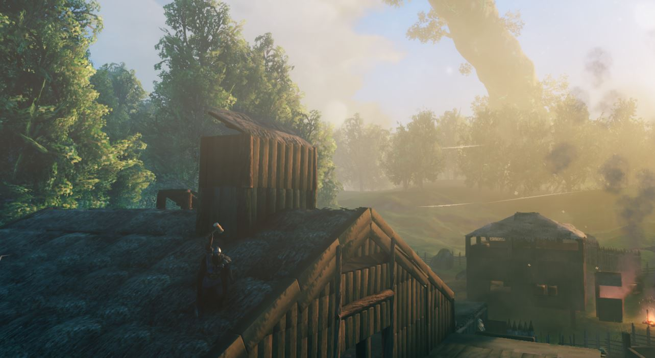 The banner image for freefly camera in Valheim. A viking standing on a house built in-game