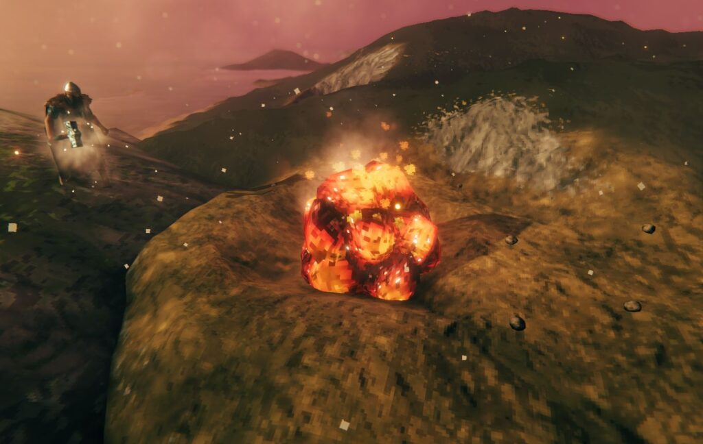 mining glowing rocks to get flametal ore in valheim