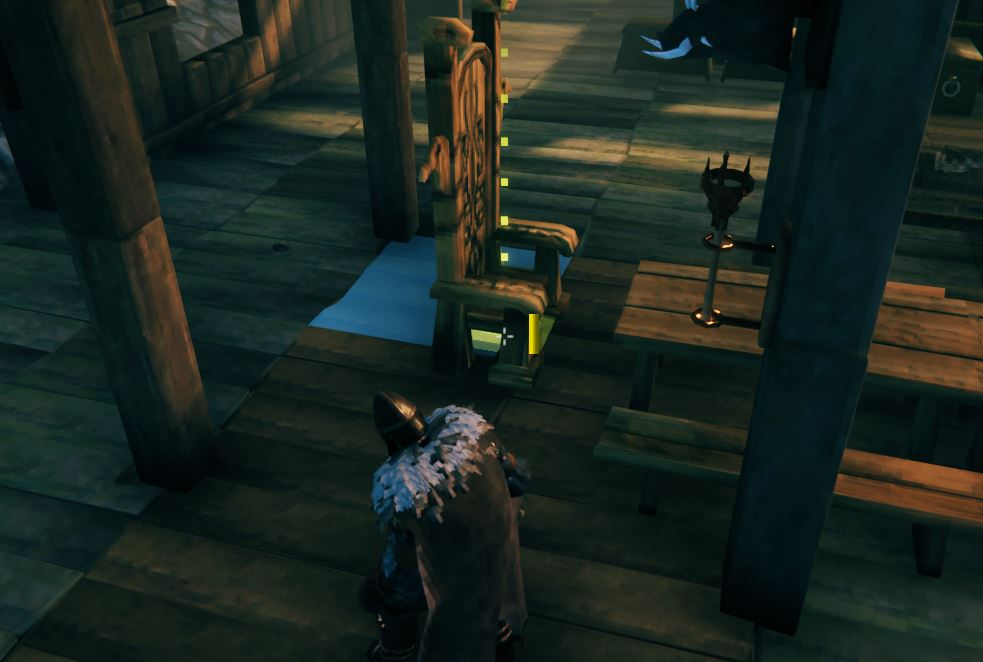 Furniture being moved to a better spot in the Valheim build