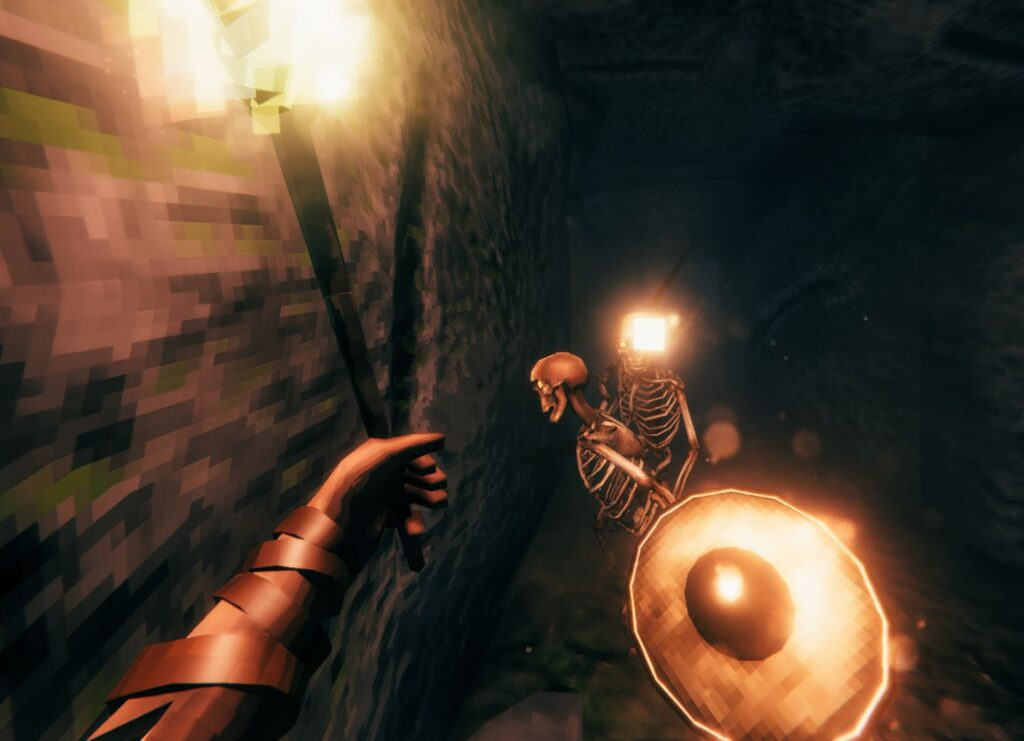 Exploring dungeons and fighting skeletons in first-person with a mod in Valheim