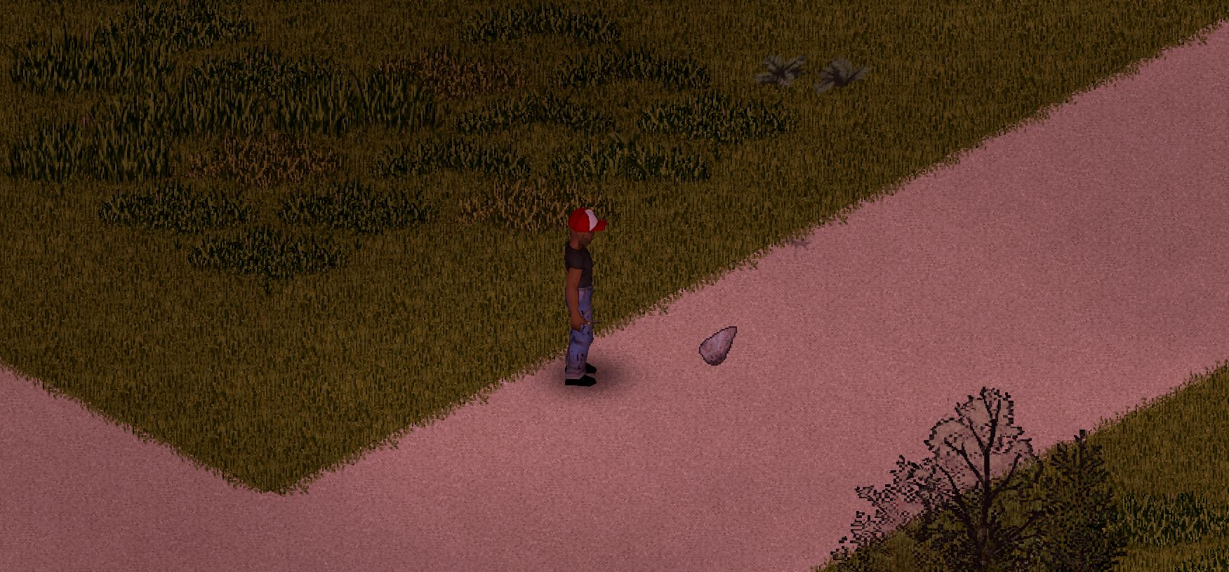 a character standing on a road next to a chipped stone in Project Zomboid